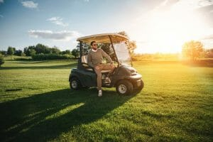 How many batteries does a golf cart use, and how long do they last