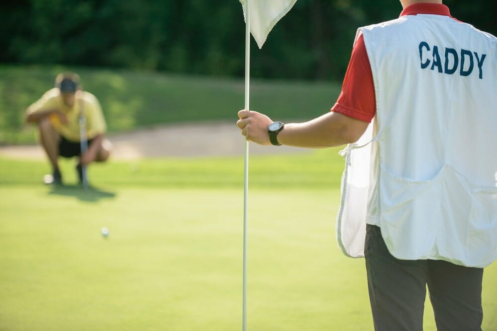 What do golf caddies do